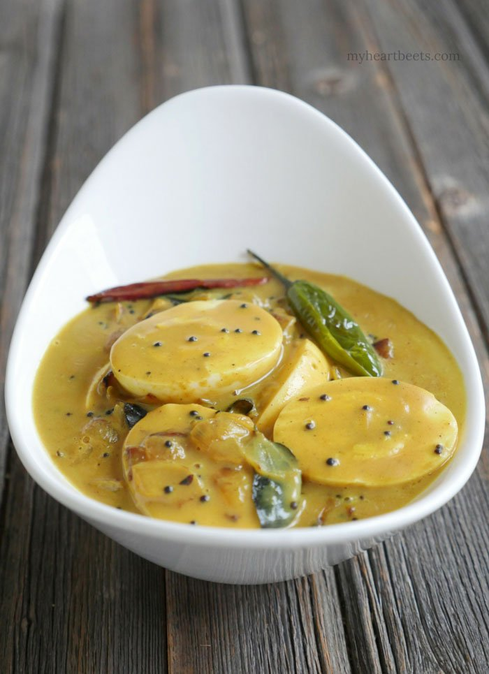 Kerala Egg Curry is a popular south Indian dish made by adding hard-boiled eggs to a spiced coconut milk sauce. Recipe on myheartbeets.com