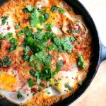 shakshouka = eggs poached in a tomato sauce
