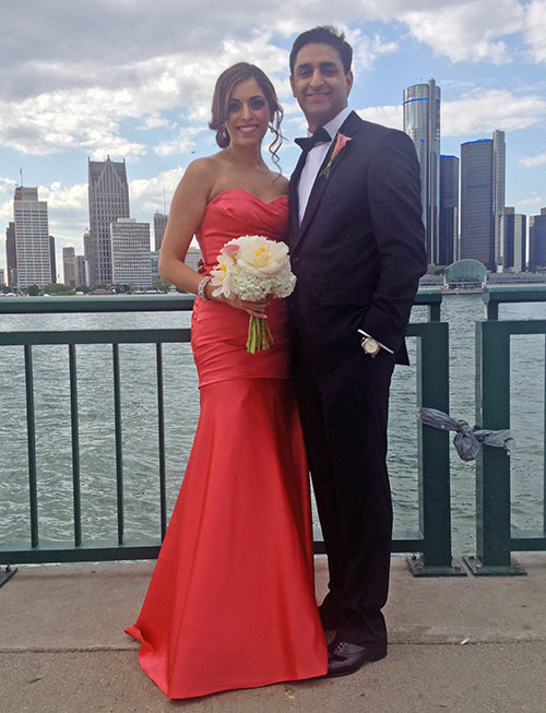 best man (hubby) + maid of honor (me) in front of the detroit skyline