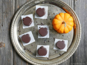 Chocolate Pumpkin Butter Cups made with a creamy spiced pumpkin sunbutter filling (dairy-free and paleo) by Ashley of MyHeartBeets.com