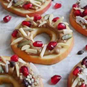 Holiday Apple Wreaths! Decorate apples with these toppings for a healthy holiday snack or dessert! Read the post to learn how to make this a fun event!! Recipe by Ashley of MyHeartBeets.com