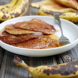 """These are gluten-free cardamom spiced banana pancakes - also known as """"Banana Malpua"""" - an Indian dessert. They're light and soft in the middle with crispy edges. Recipe by Ashley of MyHeartBeets.com"""