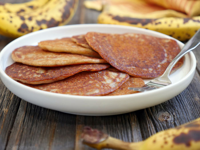 "These are gluten-free cardamom spiced banana pancakes - also known as ""Banana Malpua"" - an Indian dessert. They're light and soft in the middle with crispy edges. Recipe by Ashley of MyHeartBeets.com"