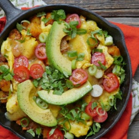 The Ultimate Breakfast Skillet: Potato and Eggs with Avocado, Tomatoes and Green Onions by Ashley of MyHeartBeets.com